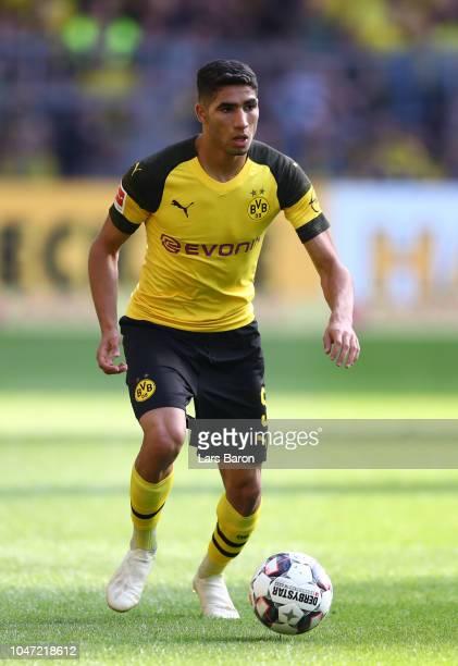 Achraf Hakimi of Dortmund runs with the ball during the Bundesliga match between Borussia Dortmund and FC Augsburg at Signal Iduna Park on October 6...