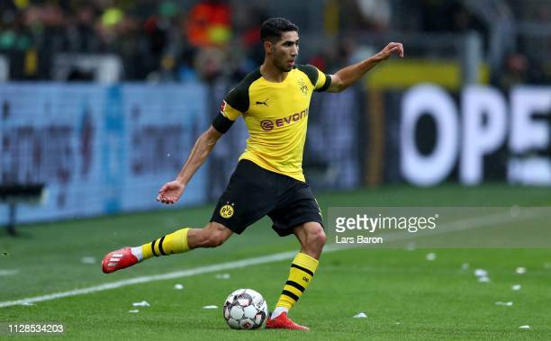 Achraf Hakimi of Dortmund runs with the ball during the Bundesliga match between Borussia Dortmund and TSG 1899 Hoffenheim at Signal Iduna Park on...