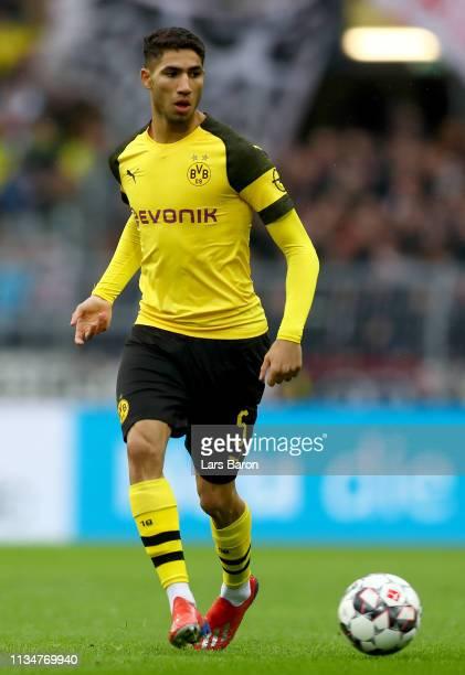 Achraf Hakimi of Dortmund runs with the ball during the Bundesliga match between Borussia Dortmund and VfB Stuttgart at Signal Iduna Park on March 09...