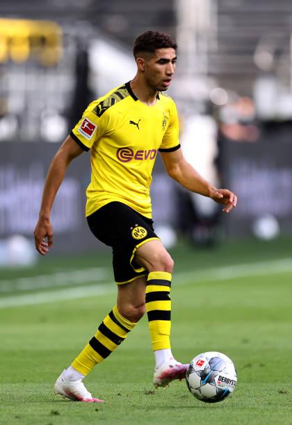 Achraf Hakimi of Dortmund runs with the ball during the Bundesliga match between Borussia Dortmund and Hertha BSC at Signal Iduna Park on June 06...