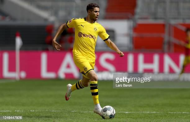 Achraf Hakimi of Dortmund runs with the ball during the Bundesliga match between Fortuna Duesseldorf and Borussia Dortmund at Merkur Spiel-Arena on...