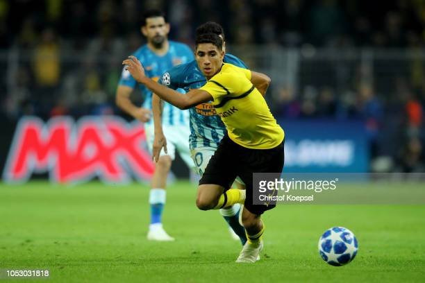 Achraf Hakimi of Dortmund runs with the ball during the Group A match of the UEFA Champions League between Borussia Dortmund and Club Atletico de...