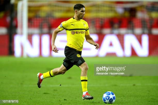 Achraf Hakimi of Dortmund runs with the ball during the UEFA Champions League Group A match between AS Monaco and Borussia Dortmund at Stade Louis II...