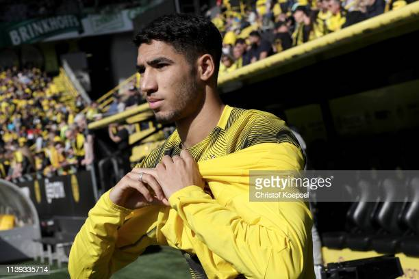 Achraf Hakimi of Dortmund warms up prior to the Bundesliga match between Borussia Dortmund and VfL Wolfsburg at Signal Iduna Park on March 30 2019 in...