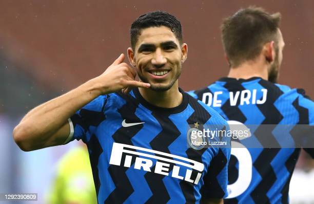 Achraf Hakimi of FC Internazionale celebrates after scoring the opening goal during the Serie A match between FC Internazionale and Spezia Calcio at...