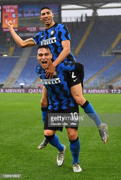 Achraf Hakimi of FC Internazionale celebrates with Lautaro Martinez after scoring the goal during the Serie A match between AS Roma and FC...