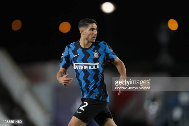 Achraf Hakimi of FC Internazionale in action during the UEFA Champions League Group B stage match between Real Madrid and FC Internazionale at...