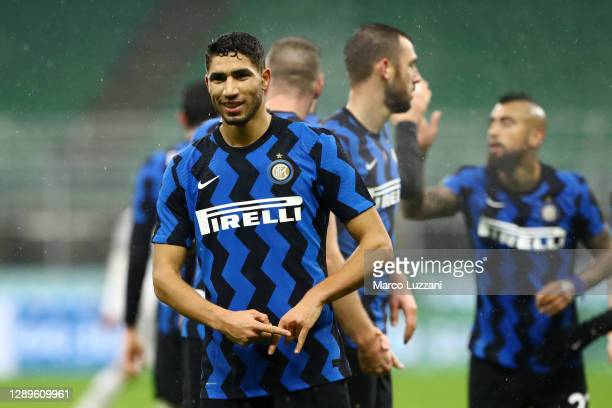 Achraf Hakimi of Inter Milan celebrates after scoring their team's second goal during the Serie A match between FC Internazionale and Bologna FC at...