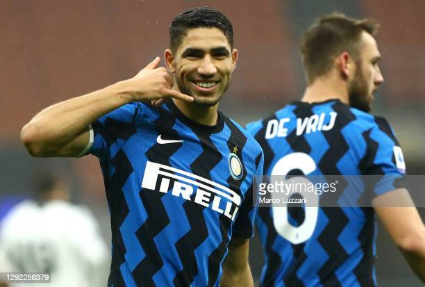 Achraf Hakimi of Inter Milan celebrates after scoring their team's first goal during the Serie A match between FC Internazionale and Spezia Calcio at...