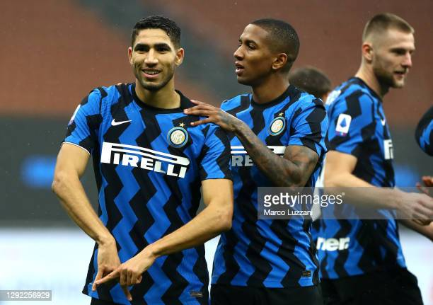 Achraf Hakimi of Inter Milan celebrates with Ashley Young after scoring their team's first goal during the Serie A match between FC Internazionale...