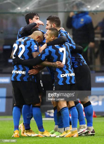 Achraf Hakimi of Inter Milan celebrates with teammates after scoring their team's third goal during the Serie A match between FC Internazionale and...