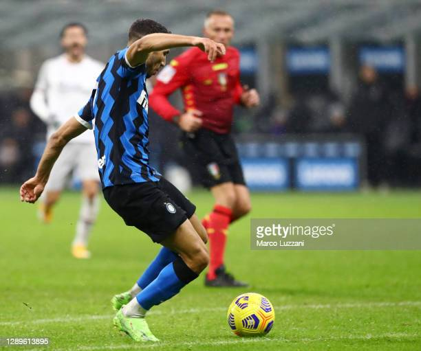 Achraf Hakimi of Inter Milan scores his sides third goal during the Serie A match between FC Internazionale and Bologna FC at Stadio Giuseppe Meazza...