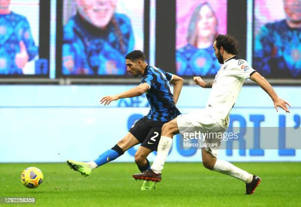 Achraf Hakimi of Inter Milan scores their team's first goal during the Serie A match between FC Internazionale and Spezia Calcio at Stadio Giuseppe...