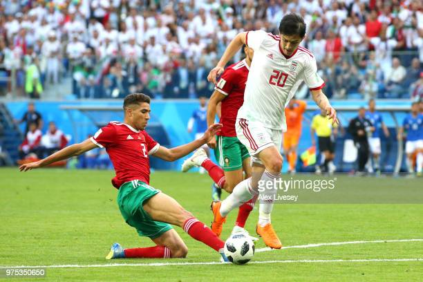 Achraf Hakimi of Morocco and Sardar Azmoun of Iran battle for the ball during the 2018 FIFA World Cup Russia group B match between Morocco and Iran...