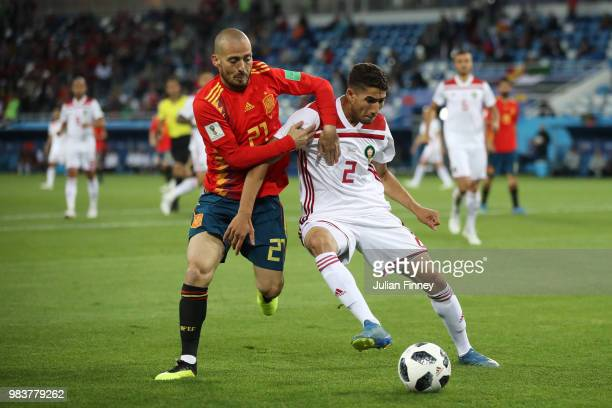 Achraf Hakimi of Morocco is challenged by David Silva of Spain during the 2018 FIFA World Cup Russia group B match between Spain and Morocco at...