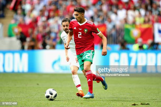Achraf Hakimi of Morocco is chased down by Bernardo Silva of Portugal during the 2018 FIFA World Cup Russia group B match between Portugal and...