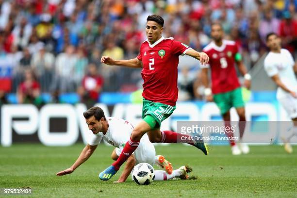 Achraf Hakimi of Morocco wins a challenge during the 2018 FIFA World Cup Russia group B match between Portugal and Morocco at Luzhniki Stadium on...