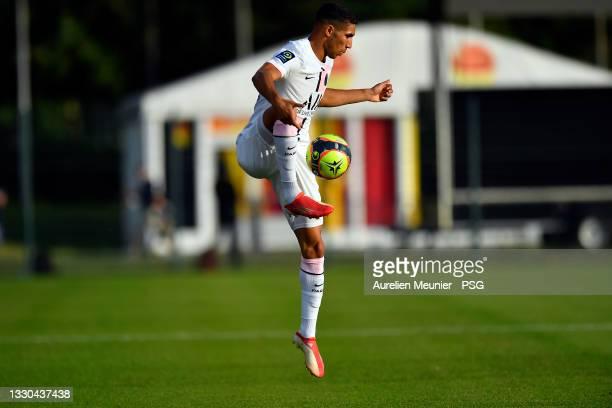 Achraf Hakimi of Paris Saint-Germain controls the ball during the pre season friendly match between Paris Saint-Germain and US Orleans at Stade De La...
