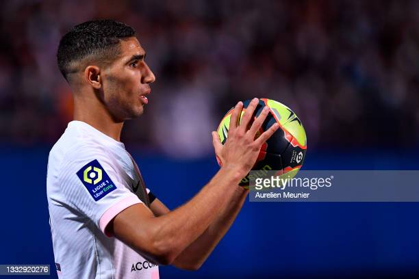 Achraf Hakimi of Paris Saint-Germain looks on during the Ligue 1 football match between Troyes and Paris at Stade de l'Aube on August 07, 2021 in...
