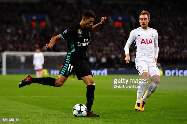 Achraf Hakimi of Real Madrid and Christian Eriksen of Tottenham Hotspur in action during the UEFA Champions League group H match between Tottenham...