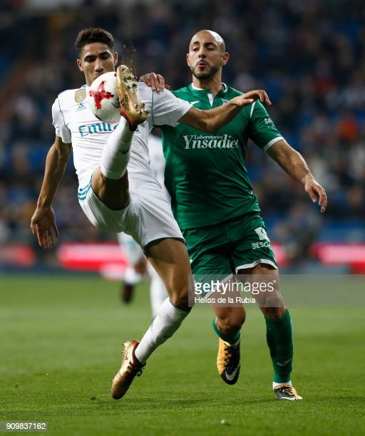 Achraf Hakimi of Real Madrid and NordinÊAmrabat of Leganes compete for the ball during the Spanish Copa del Rey Quarter Final Second Leg match...