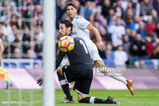 Achraf Hakimi of Real Madrid attempts a kick while scoring his goal during La Liga 201718 match between Real Madrid and Sevilla FC at Santiago...
