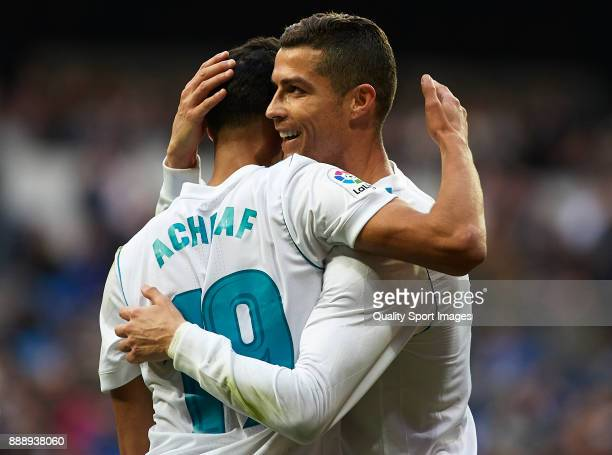 Achraf Hakimi of Real Madrid celebrates scoring his team's fifth goal with his teammate Cristiano Ronaldo during the La Liga match between Real...