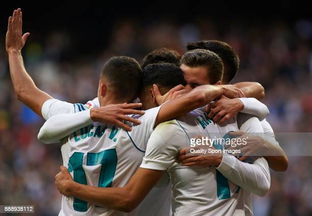 Achraf Hakimi of Real Madrid celebrates scoring his team's fifth goal with his teammates during the La Liga match between Real Madrid and Sevilla at...