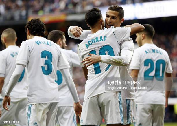 Achraf Hakimi of Real Madrid celebrates with Cristiano Ronaldo after scoring their team's fifth goal during the La Liga match between Real Madrid and...