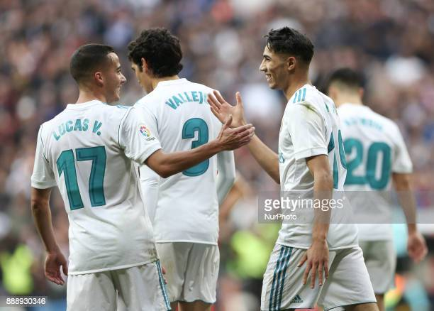 Achraf Hakimi of Real Madrid celebrates with Lucas Vazquez after scoring their team's fifth goal during the La Liga match between Real Madrid and...