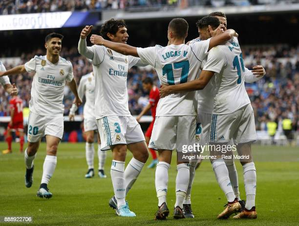 Achraf Hakimi of Real Madrid celebrates with team mates after scoring their team's fifth goal during the La Liga match between Real Madrid and...