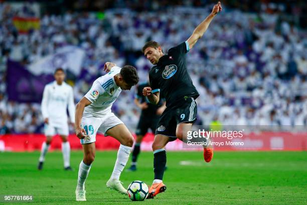 Achraf Hakimi of Real Madrid CF competes for the ball with John Guidetti of RC Celta de Vigo during the La Liga match between Real Madrid and Celta...