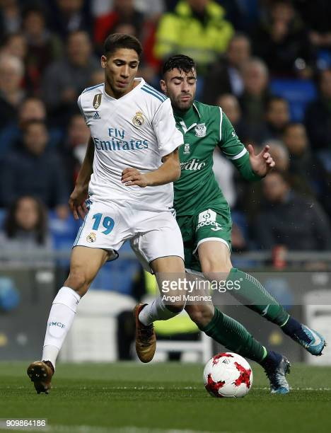 Achraf Hakimi of Real Madrid competes for the ball with Diego Rico of Leganes during the Spanish Copa del Rey Quarter Final Second Leg match between...