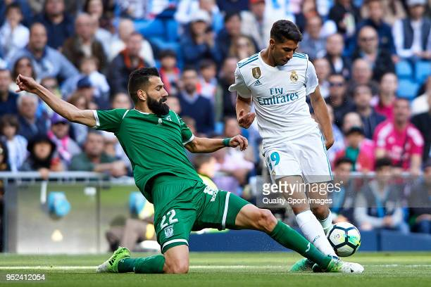 Achraf Hakimi of Real Madrid competes for the ball with Dimitrios Siovas of Leganes during the La Liga match between Real Madrid and Leganes at...
