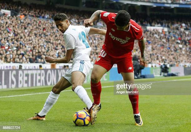 MADRID SPAIN DECEMBER Achraf Hakimi of Real Madrid competes for the ball with Ever Banega of Sevilla during the La Liga match between Real Madrid and...