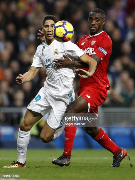 Achraf Hakimi of Real Madrid competes for the ball with Lionel Carole of Sevilla during the La Liga match between Real Madrid and Sevilla at Estadio...
