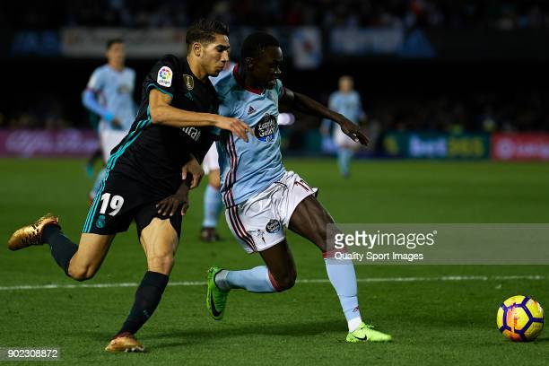 Achraf Hakimi of Real Madrid competes for the ball with Pione Sisto of Celta de Vigo during the La Liga match between Celta de Vigo and Real Madrid...