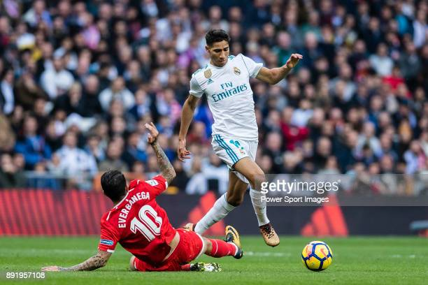 Achraf Hakimi of Real Madrid fights for the ball with Ever Maximiliano Banega of Sevilla FC during the La Liga 201718 match between Real Madrid and...