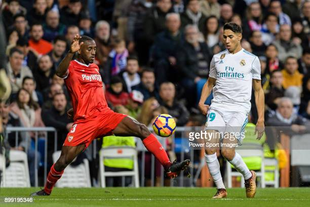 Achraf Hakimi of Real Madrid in action against Lionel Carole of Sevilla FC during La Liga 201718 match between Real Madrid and Sevilla FC at Santiago...