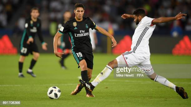 Achraf Hakimi of Real Madrid is challenged by Eissa Mohamed of Al Jazira during the FIFA Club World Cup UAE 2017 semifinal match between Al Jazira...