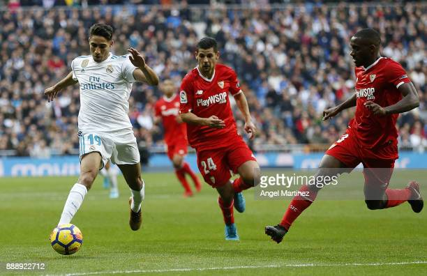Achraf Hakimi of Real Madrid is chased by Nolito of Sevilla during the La Liga match between Real Madrid and Sevilla at Estadio Santiago Bernabeu on...