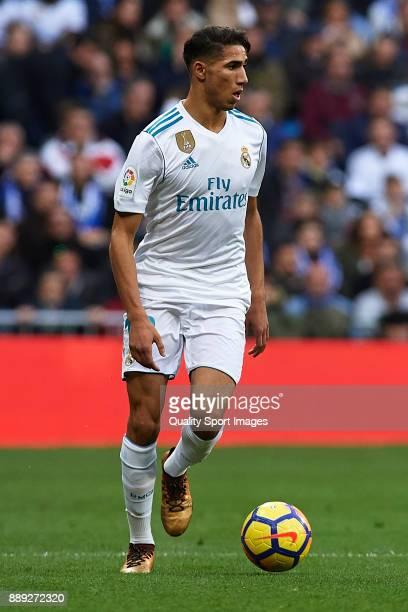 Achraf Hakimi of Real Madrid runs with the ball during the La Liga match between Real Madrid and Sevilla at Estadio Santiago Bernabeu on December 9...