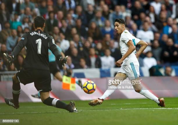 Achraf Hakimi of Real Madrid scores a goal during the La Liga match between Real Madrid and Sevilla at Estadio Santiago Bernabeu on December 9 2017...