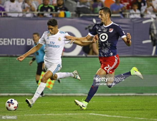 Achraf Hakimi of Real Madrid shoots around Matt Hedges of the MLS AllStars during the 2017 MLS All Star Game at Soldier Field on August 2 2017 in...