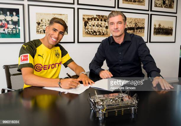Achraf Hakimi signs a new contract with Borussia Dortmund and Michael Zorc at Dortmund on July 11 2018 in Dortmund Germany