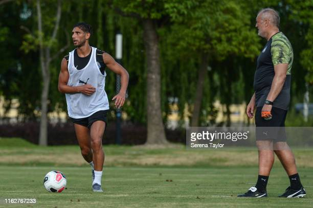 Achraf Lazaar looks to pass the ball whilst Newcastle United's Head of Under 23's Coach Neil Redfearn looks on during the Newcastle United Pre Season...