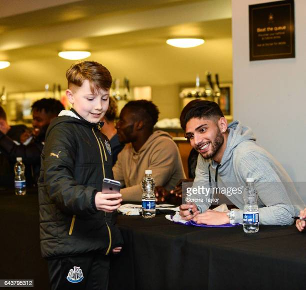 Achraf Lazaar of Newcastle United poses for a photo with a fan during the Junior Magpies signing session at StJames' Park on February 22 2017 in...