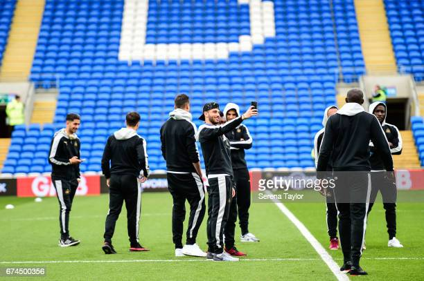 Achraf Lazaar of Newcastle United stands on the pitch taking a selfie prior to kick off of the Sky Bet Championship match between Cardiff City and...