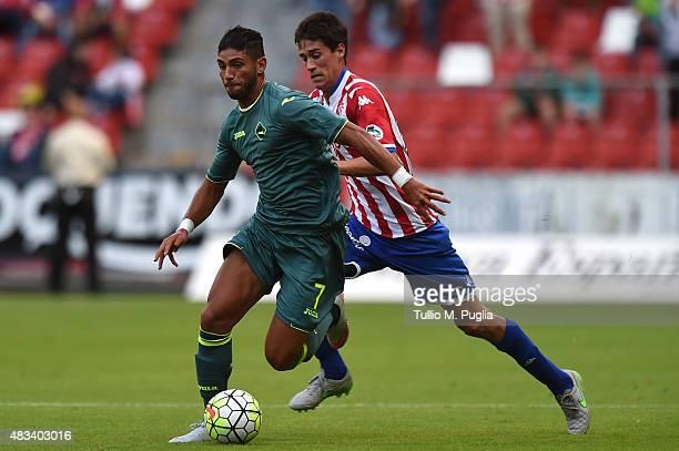 Achraf Lazaar of Palermo and Bernardo Jose Espinosa Zuniga of Gijon compete for the ball during the preseason friendly match between Real Sporting de...