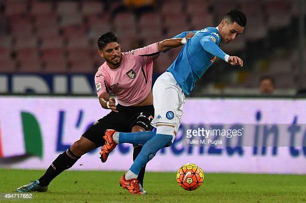 Achraf Lazaar of Palermo and Jose Callejon of Napoli compete for the ball during the Serie A match between SSC Napoli and US Citta di Palermo at...